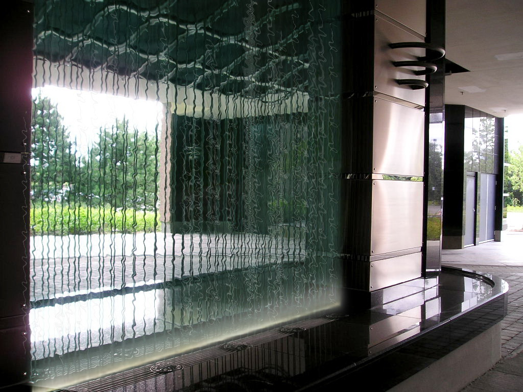 The water wall  The water wall features stainless provides glistening steel cables amplified with the streaming water surrounded by polished granite.