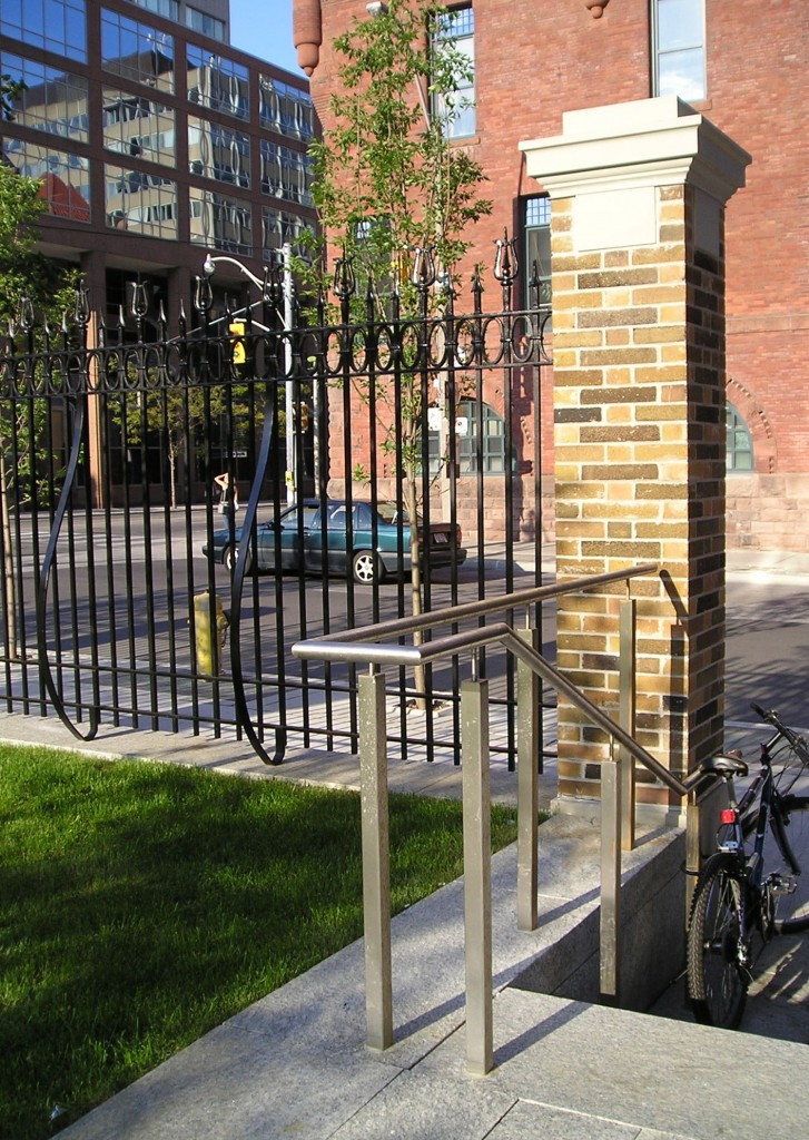 Historic structures are blended with contemporary forms. The existing fence was refurbished and reinstalled to reflect the history of the site.