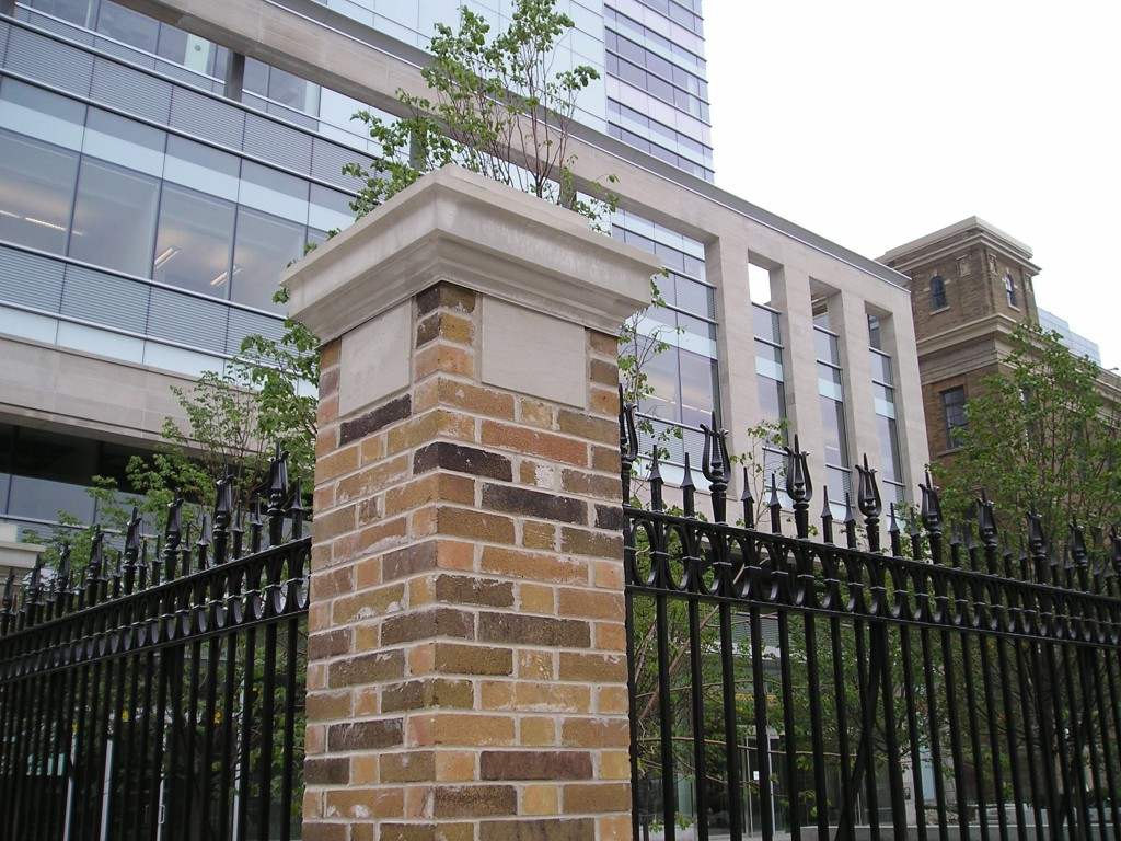 Detail of one of the restored brick and masonry columns.