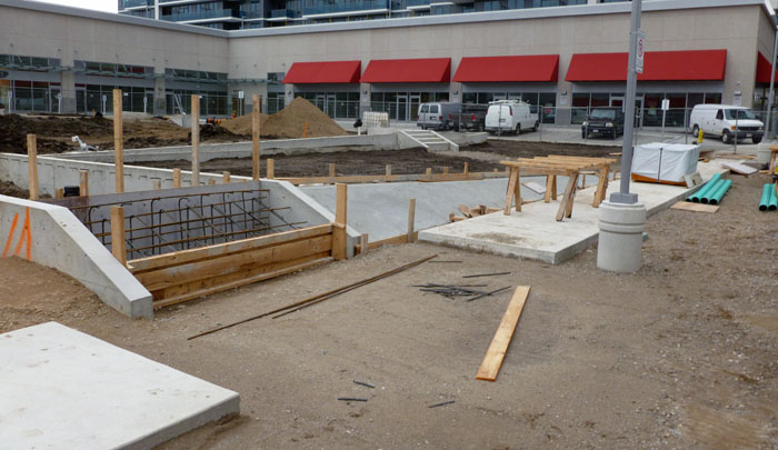Concrete core for brick-clad walls are being formed and poured.